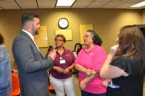 Grant Eloi meets with constituents prior to being selected superintendent.